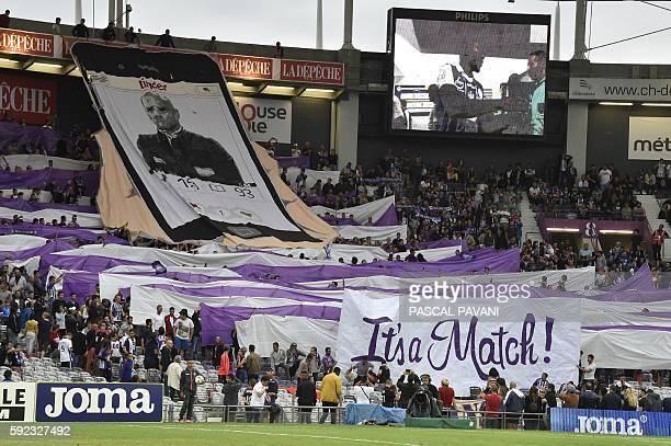 Toulouse's supporters hold a banner parodying the social application Tinder and picturing Toulouse's coach Pascal Dupraz during the French L1...