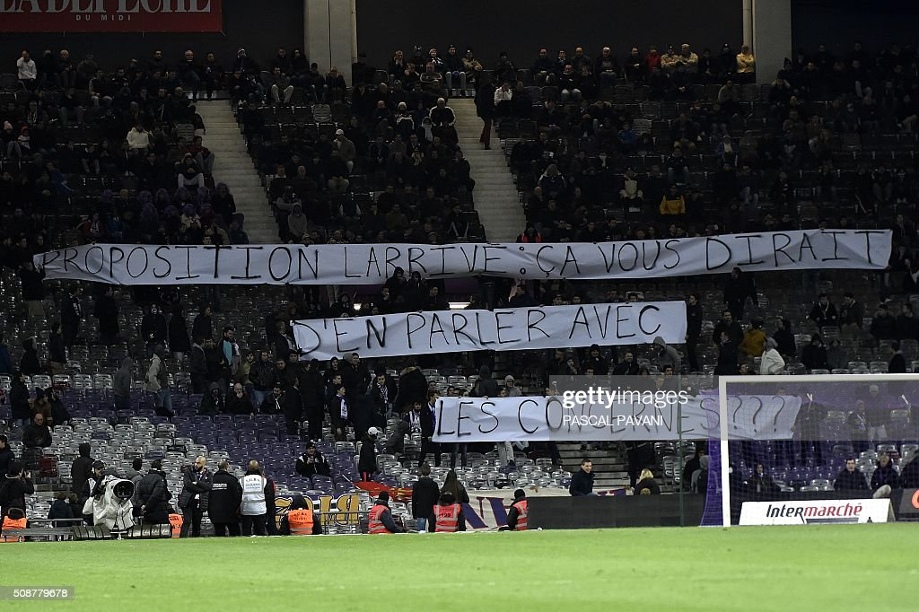 Toulouse's supporters hold a banner reading 'Larrive proposal : why don't you talk with the people it may concern?' related to a law proposal against hooliganism by MP Larrive (Les Republicains, main opposition right-wing party) during the French L1 football match Toulouse against Nantes on February 6, 2016 at the Municipal Stadium in Toulouse. AFP PHOTO / PASCAL PAVANI / AFP / PASCAL PAVANI