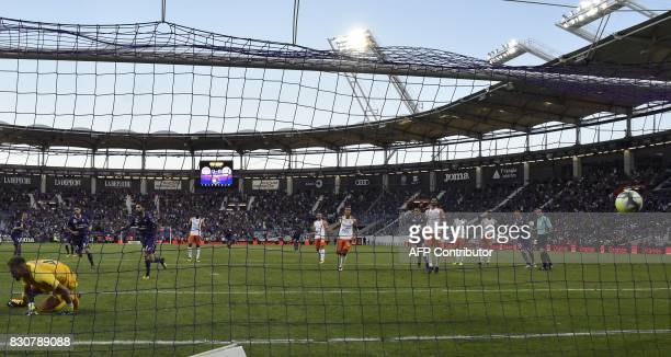 Toulouse's Swedish midfielder Jimmy Durmaz celebrates after scoring a penalty past Montpellier's French goalkeeper Benjamin Lecomte during the French...