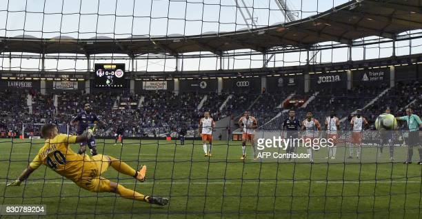 Toulouse's Swedish midfielder Jimmy Durmaz scores a penalty past Montpellier's French goalkeeper Benjamin Lecomte during the French L1 football match...