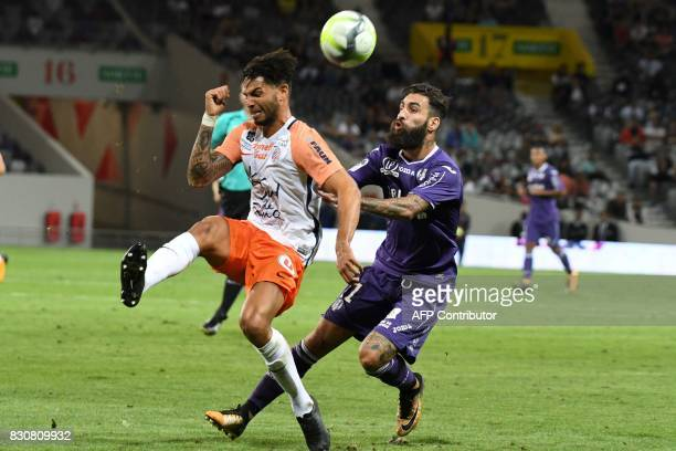 Toulouse's Swedish midfielder Jimmy Durmaz vies with Montpellier's Portuguese defender Pedro Mendes during the French L1 football match Toulouse...