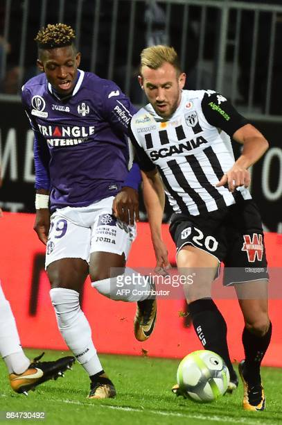 Toulouse's Swiss defender Francois Moubandje vies with Angers' French midfielder Flavien Tait during the French L1 Football match between Angers and...