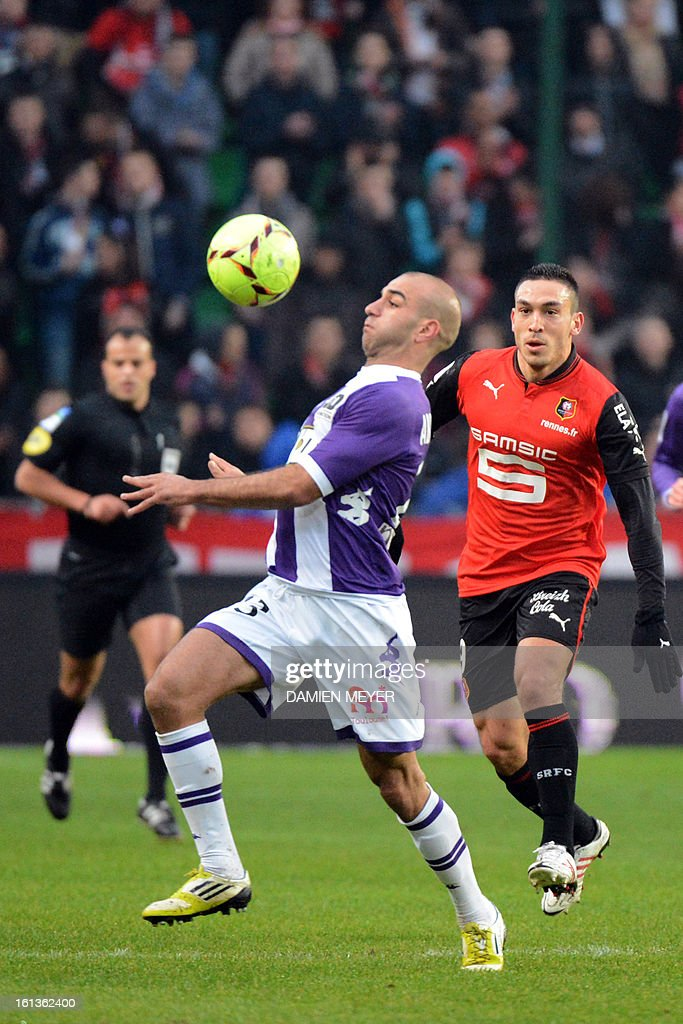 Toulouse's Tunisian defender Aymen Abdennour (L) controls the ball in front of Rennes' French forward Mevlut Erding during a French L1 football match betwenn Rennes and Toulouse on February 10, 2013 at the route de Lorient stadium in Rennes, western France.