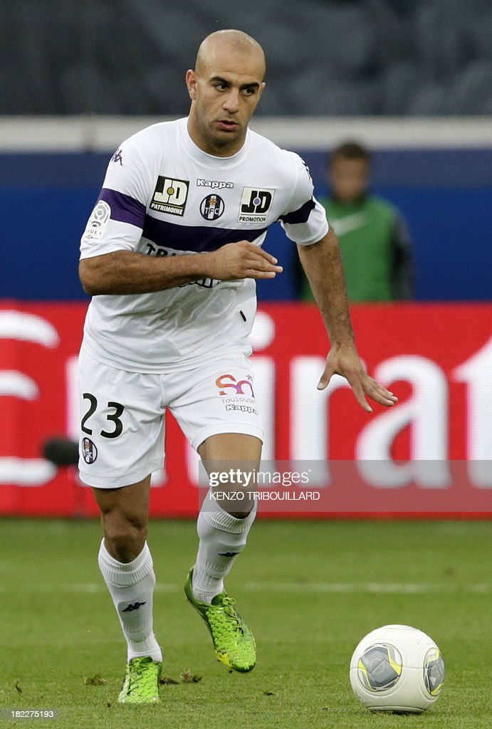 Toulouse's Tunisian defender Aymen Abdennour runs with the ball during the French L1 football match between Paris Saint-Germain and Toulouse at the Parc des Princes Stadium in Paris on September 28, 2013. PSG won 2-0.