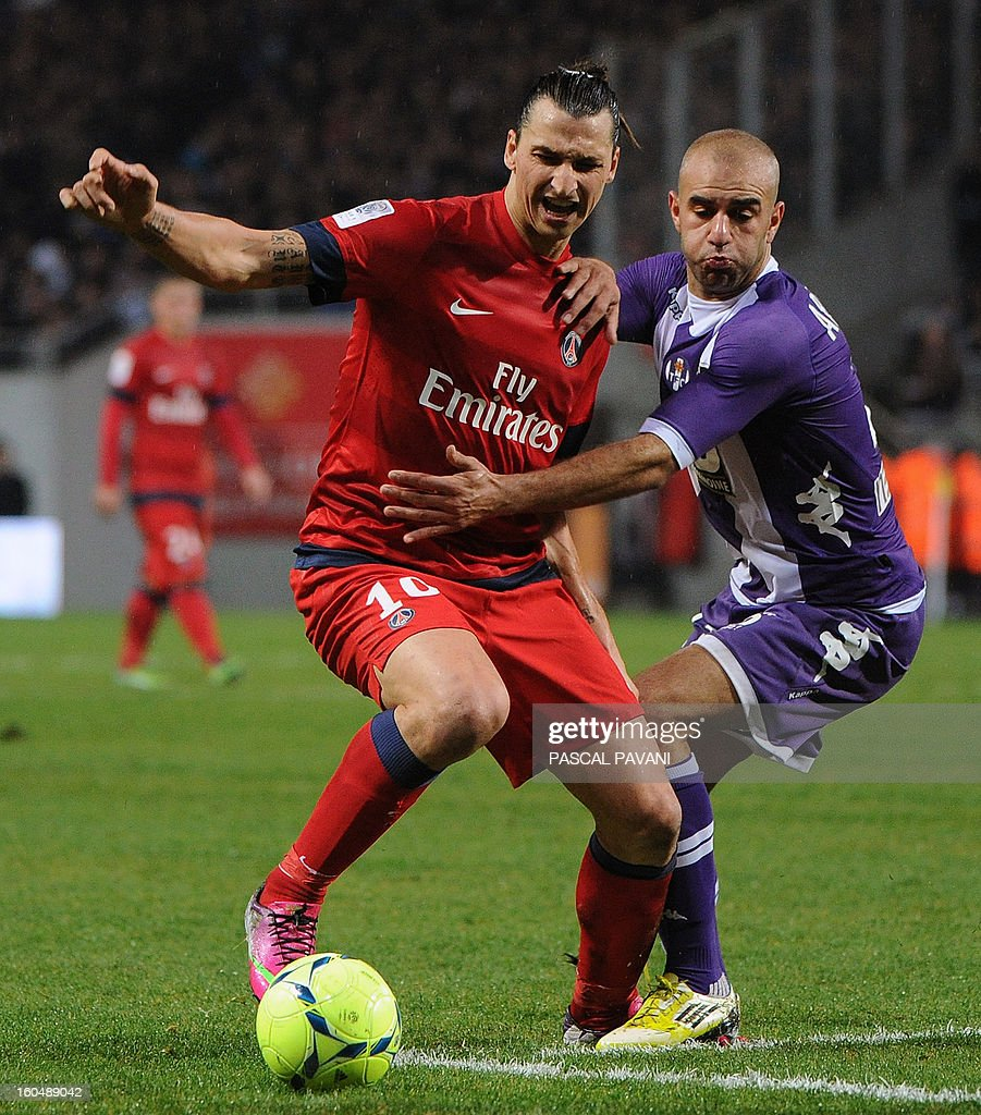 Toulouse's Tunisian defender Aymen Abdennour (R) vies with Paris Saint-Germain' Swedish forward Zlatan Ibrahimovic during the French L1 football match Toulouse (TFC) vs Paris Saint-Germain (PSG) on February 1, 2013 at the Stade Municipal in Toulouse.