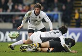 Toulouse's Wing Cedric Heymans eyes the ball after a tackle by Toulouse's Fullback Clement Poitrenaud on London Wasps' centre Dominc Waldouk during...