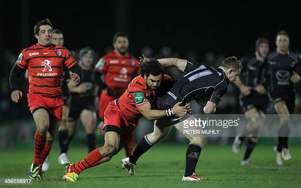 Toulouse's wing Yoann Huget tackles by Connacht's wing Matt Healy during the European Cup rugby union pool match between Connacht Rugby and Toulouse...