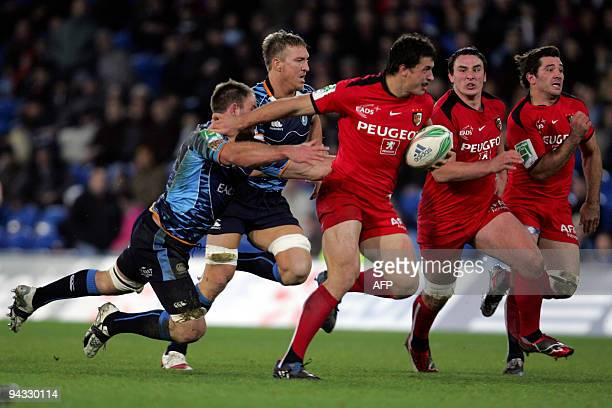 Toulouse's Yannick Jauzion gets clear of Cardiff Blues' Xavier Rush and Andy Powell as his teammates look on in the Heineken Cup Rugby Union match at...