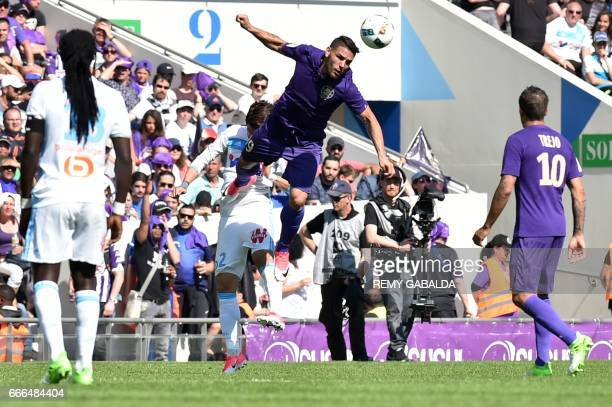 Toulouses's Andy Delort heads the ball during the French L1 football match Toulouse vs Marseille on April 9 2017 at the Municipal Stadium in Toulouse...
