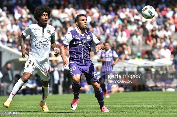 Toulouses's French forward Andy Delort vies with Nice's Brazilian defender Dante during the French L1 football match Toulouse vs Nice on April 23...