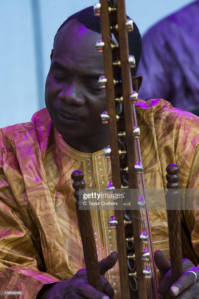 <a gi-track='captionPersonalityLinkClicked' href=/galleries/search?phrase=Toumani+Diabate&family=editorial&specificpeople=828405 ng-click='$event.stopPropagation()'>Toumani Diabate</a> of Afrocubism performs on stage during the Bonnaroo Music and Arts Festival on June 8, 2012 in Manchester, Tennessee.