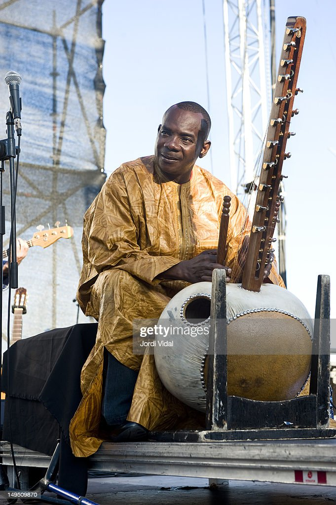 <a gi-track='captionPersonalityLinkClicked' href=/galleries/search?phrase=Toumani+Diabate&family=editorial&specificpeople=828405 ng-click='$event.stopPropagation()'>Toumani Diabate</a> of Antunes, Diabate and Scandurra performs on stage during Cruilla Barcelona Festival at Parc Del Forum on July 7, 2012 in Barcelona, Spain.