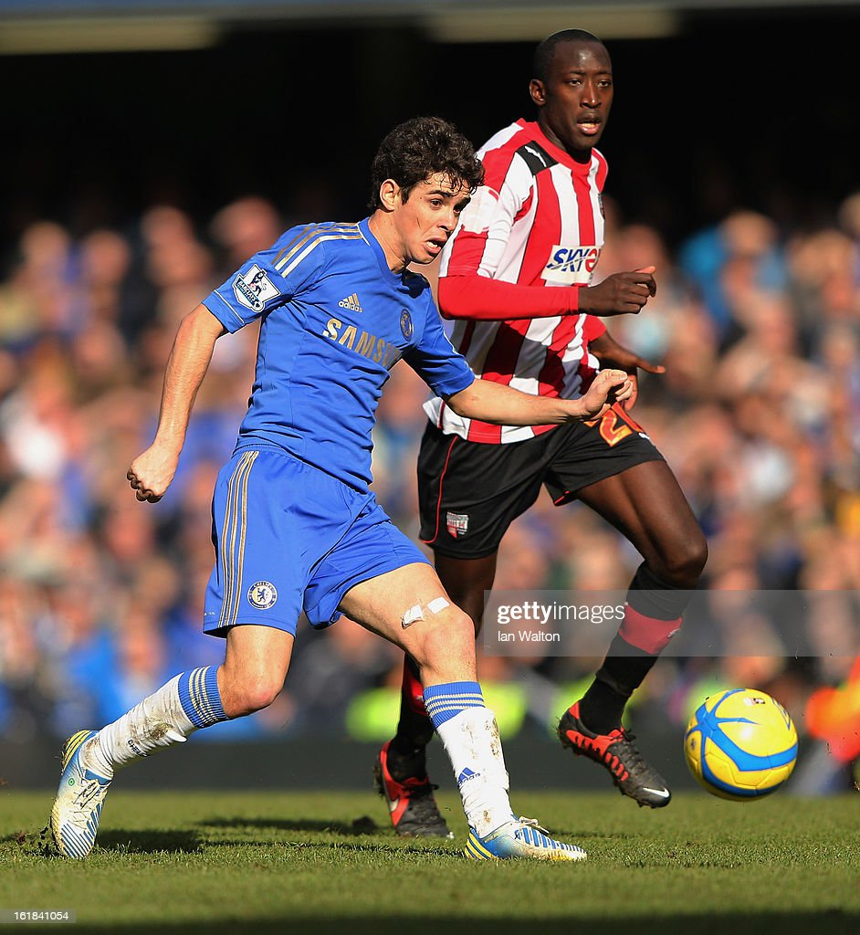 Toumani Diagouraga of Brentford challenges Oscar of Chelsea during the FA Cup Fourth Round Replay match between Chelsea and Brentford at Stamford Bridge on February 17, 2013 in London, England.