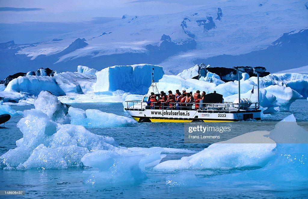 Tour boat among icebergs in Lake Jokulsarlon.