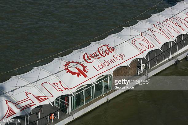 A tour boat dock along The Thames River is viewed from the London Eye on September 11 in London England The collapse of Great Britain following the...