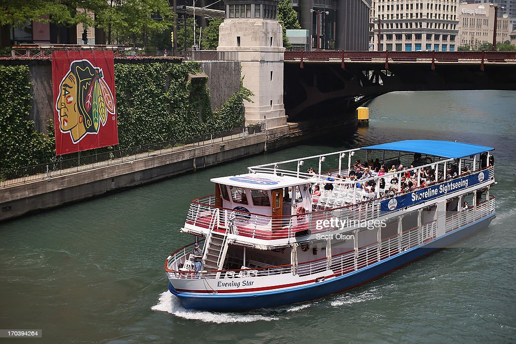 A tour boat passes by a Chicago Blackhawks' banner on the Chicago River in the Loop on June 12, 2013 in Chicago, Illinois. The Chicago Blackhawks will match up against the Boston Bruins tonight at the United Center in the first game on the NHL Stanley Cup playoffs.