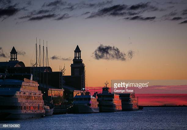 Tour boats docked at Navy Pier are viewed before sunrise on October 10 2015 in Chicago Illinois Chicago the third largest city in the United States...