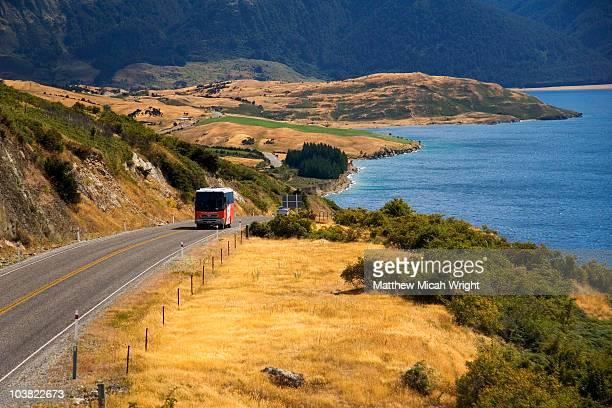 Tour bus climbing hill by Lake Wanaka.