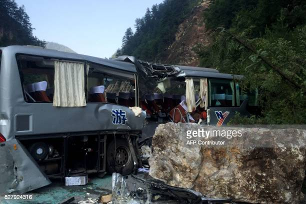 A tour bus damaged during an earthquake is seen in Jiuzhaigou in China's southwestern Sichuan province on August 9 2017 At least 12 people were...