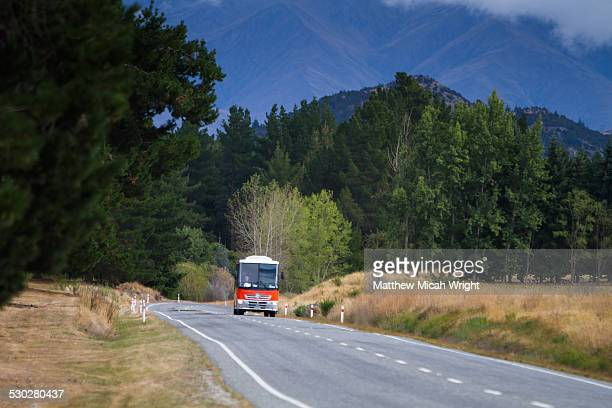 A tour bus drives through Wanaka