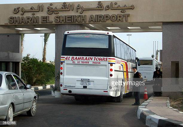 A tour bus passes Egyptian security as it arrives at Sharm El Sheikh International Airport 03 January 2004 A total of 148 people were aboard a...