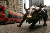 A tour bus passes the Wall Street bull in the financial district January 22 2007 in New York City In a study commissioned by New York City Mayor...