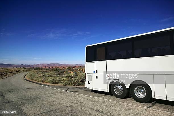 Tour bus sightseeing in Devils Garden, Arches National Park, Utah