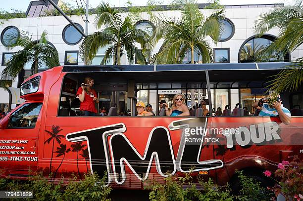 A TMZ tour bus travels on Rodeo Drive in Beverly Hills California September 3 2013 AFP PHOTO / Robyn Beck