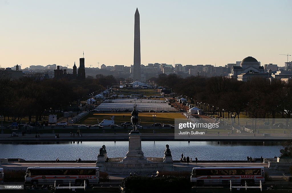 Tour buses and tourists are seen near the U.S. Capitol on January 18, 2013 in Washington, DC. The U.S. capital is preparing for the second inauguration of U.S. President Barack Obama, which will take place on January 21.
