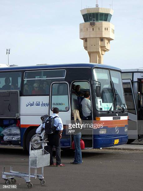 Tour buses collect packagetourists arriving at Sharm El Sheikh International Airport 03 January 2004 A total of 148 people were aboard a charter jet...