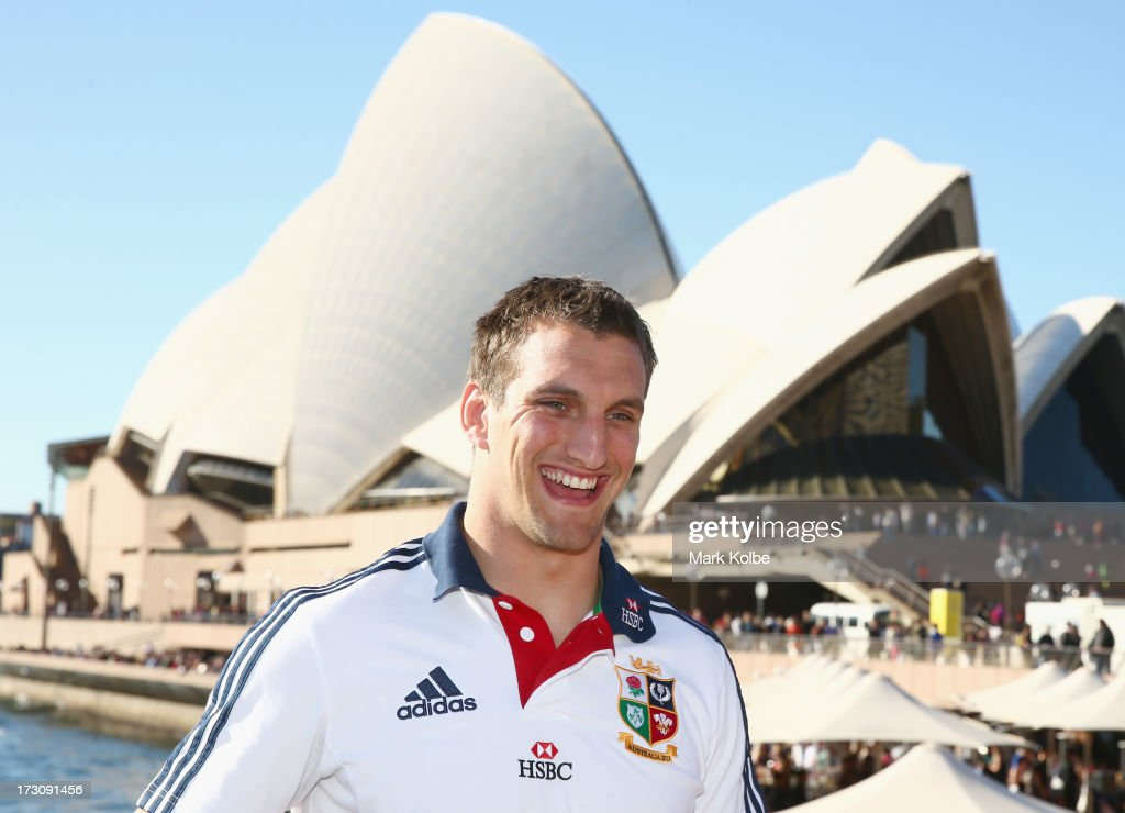 Tour captain <a gi-track='captionPersonalityLinkClicked' href=/galleries/search?phrase=Sam+Warburton+-+Rugby+Player&family=editorial&specificpeople=4234449 ng-click='$event.stopPropagation()'>Sam Warburton</a> shares a laugh as he waits to pose with the Tom Richards Cup at the Sydney Opera House during a British & Irish Lions media session at the Sydney Opera House on July 7, 2013 in Sydney, Australia.