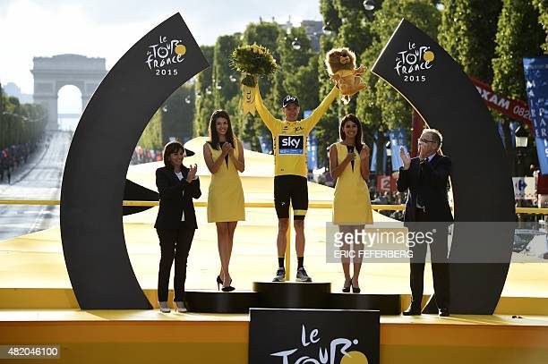 Tour de France 2015's winner Great Britain's Christopher Froome celebrates his victory on the podium on the ChampsElysees avenue flanked by Paris...