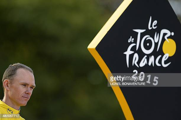 Tour de France 2015's winner Great Britain's Christopher Froome celebrates his victory on the podium on the ChampsElysees avenue at the end of the...