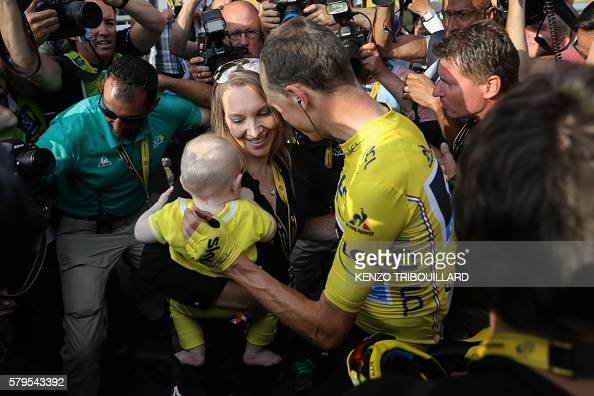 Tour de France 2016's winner Great Britain's Christopher Froome wearing the overall leader's yellow jersey celebrates with his wife Michelle Cound...