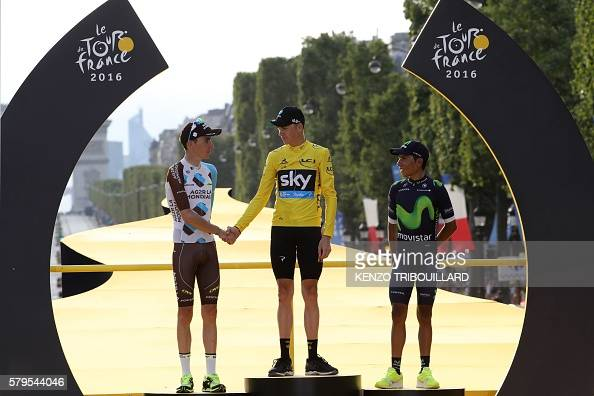 Tour de France 2016's winner Great Britain's Christopher Froome wearing the overall leader's yellow jersey shakes hands with secondplaced Romain...