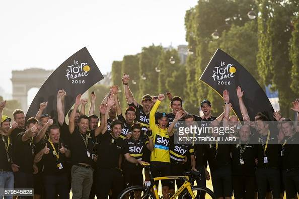 TOPSHOT Tour de France 2016's winner Great Britain's Christopher Froome wearing the overall leader's yellow jersey celebrates with his teammates and...