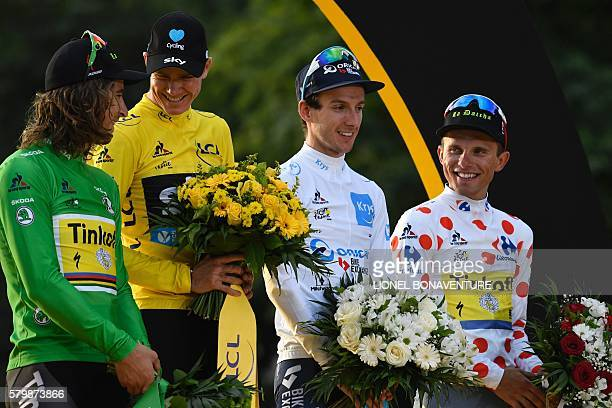 Tour de France 2016's winner Great Britain's Christopher Froome wearing the overall leader's yellow jersey Slovakia's Peter Sagan wearing the best...