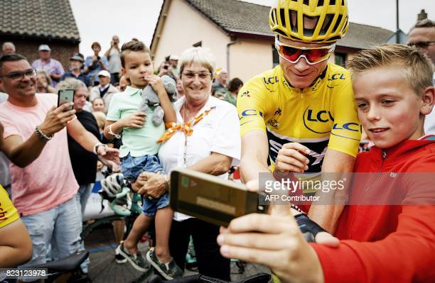 Tour de France 2017 winner Britain's Chris Froome poses for a 'selfie' during the 'Acht van Chaam' Eight of Chaam a traditional cycling event in...