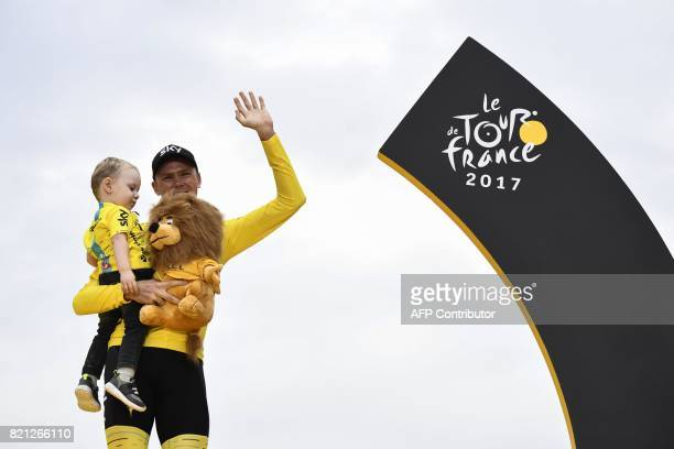 Tour de France 2017's winner Great Britain's Christopher Froome celebrates his overall leader yellow jersey with his child Kellan on the podium at...