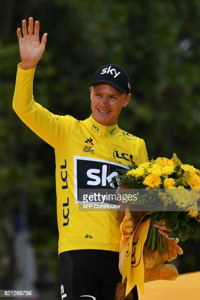 Tour de France 2017's winner Great Britain's Christopher Froome celebrates his overall leader yellow jersey on the podium at the end of the 103 km...