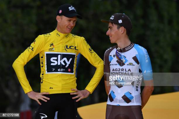 Tour de France 2017's winner Great Britain's Christopher Froome wearing the overall leader's yellow jersey speaks with thirdplaced France's Romain...