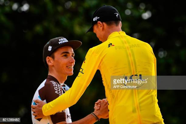 TOPSHOT Tour de France 2017's winner Great Britain's Christopher Froome wearing the overall leader's yellow jersey shakes hands with thirdplaced...