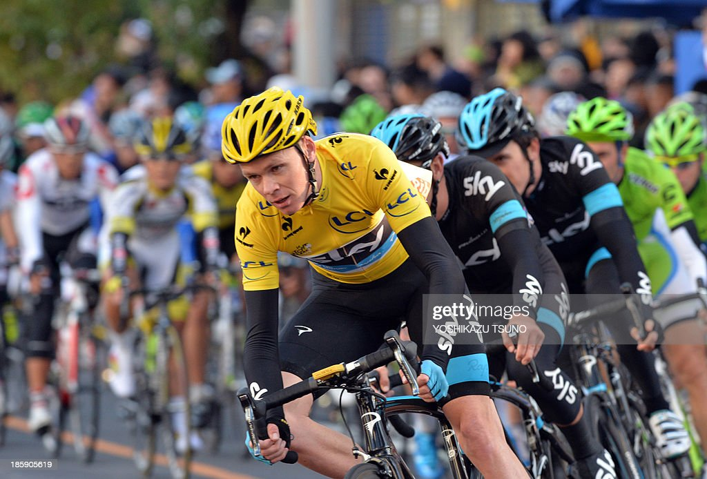Tour de France champion British Christopher Froome of Sky Procycling leads the pack of cyclists during the Saitama criterium cycle race in Saitama...