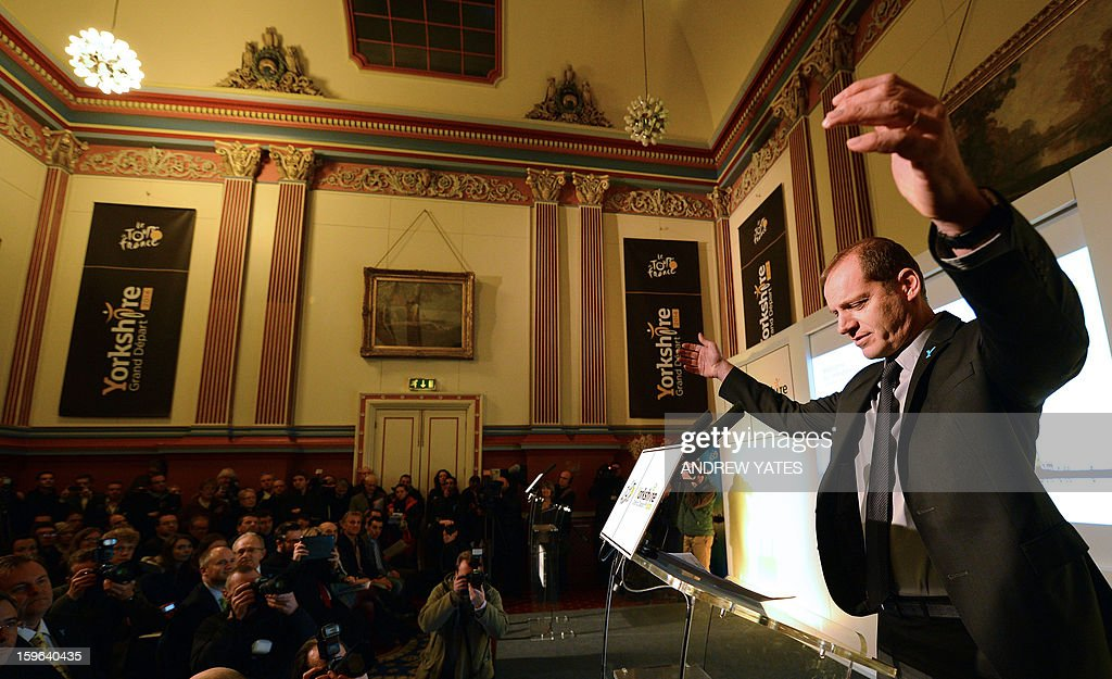 Tour de France director Christian Prudhomme geastures during a press conference to announce the routes for the 2014 Tour De France at Leeds Town Hall in Leeds, northern England, on January 17, 2013. The 2014 Tour de France will start with a stage between Leeds and Harrogate in the northern English county of Yorkshire on July 5, organisers of cycling's most prestigious and gruelling race announced. AFP PHOTO/ANDREW YATES.