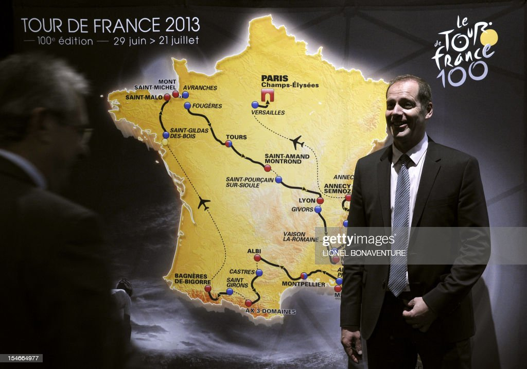 Tour de France director Christian Prudhomme poses after unveiling the 2013 cycling classic Tour de France route during a press conference in Paris on October 24, 2012. The 100th edition of the Tour will take place from June 29 to July 21 and will start in Corsica for the first time in its history.