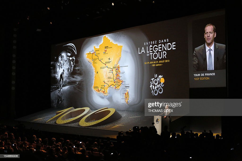 Tour de France director Christian Prudhomme unveils the 2013 cycling classic Tour de France route during a press conference on October 24, 2012 in Paris. The 100th edition of the Tour will take place from June 29 to July 21 and will start in Corsica for the first time in its history.