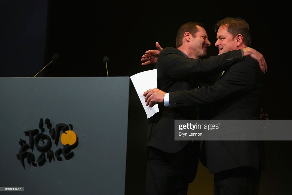 Tour de France Director Christian Prudhommme greets Chief Executive of Welcome to Yorkshire Gary Verity at the route presentation of 2014 Tour de France at the Palais des Congres de Paris on October 23, 2013 in Paris, France. The 101st edition of the Tour de France will start with 3 stages in England.