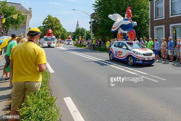 Tour de France de publicité Le Gualois les véhicules avec caravane