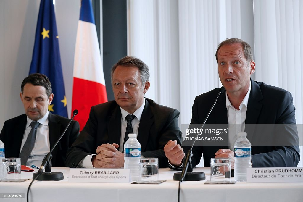 Tour de France race director Christian Prudhomme (R), flanked by French Minister for Sports Thierry Braillard (C) and French Minister for Higher Education and Research Thierry Mandon (L), speaks during a press conference on mechanical fraud, in Paris, on June 27, 2016. Thermal cameras will be used in this year's Tour de France to fight against motor cheats, French Minister of State for Sport Thierry Braillard announced on Monday. The cameras, which can detect a motor in a bicycle, have been developed by the Atomic Energy Commission (CEA) at the request of the French government. / AFP / Thomas SAMSON