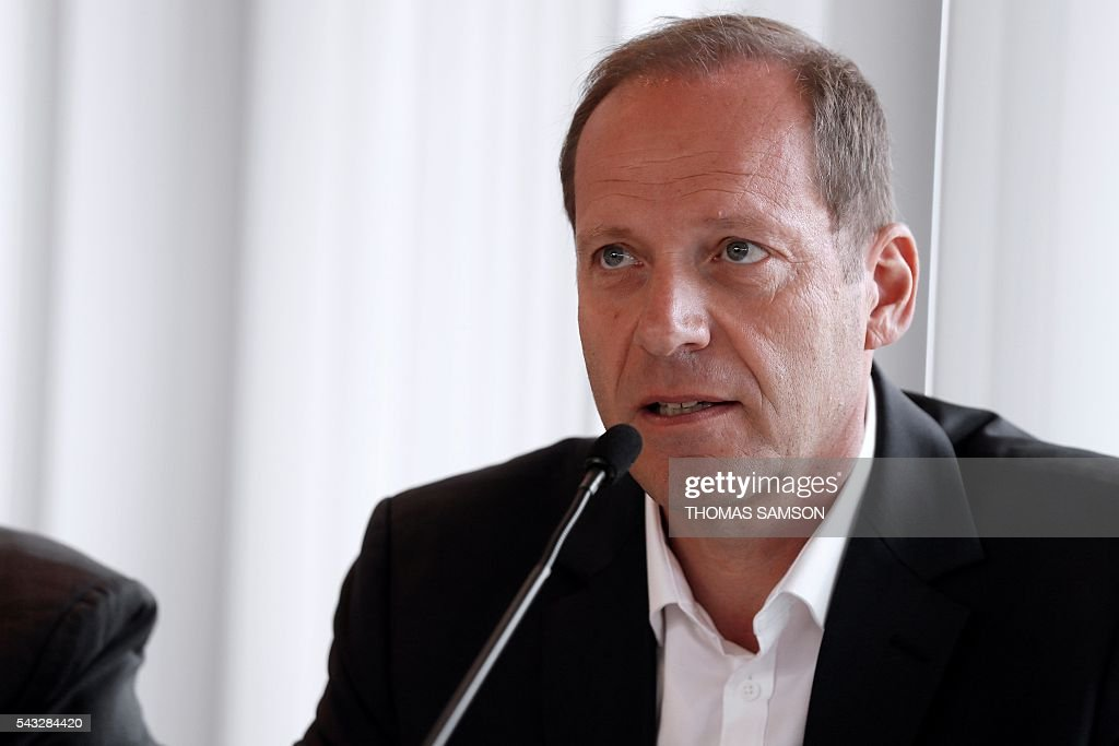 Tour de France race director Christian Prudhomme speaks during a press conference on mechanical fraud, in Paris, on June 27, 2016. Thermal cameras will be used in this year's Tour de France to fight against motor cheats, French Minister of State for Sport Thierry Braillard announced on Monday. The cameras, which can detect a motor in a bicycle, have been developed by the Atomic Energy Commission (CEA) at the request of the French government. SAMSON